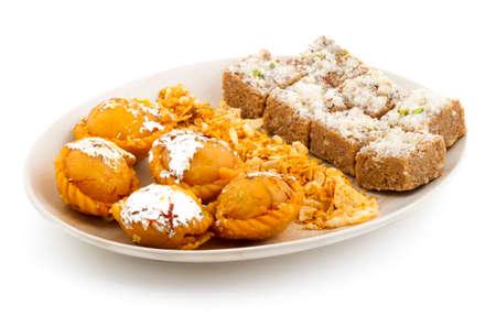 Indian Traditinal sweet food chandrakala with gond pak and namkeen Stock Photo
