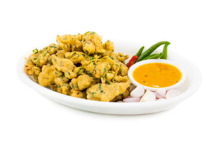 Bhajiya or Pakora is made with gram flour and spinach, This is the favorite street food of Indian and Pakistani people
