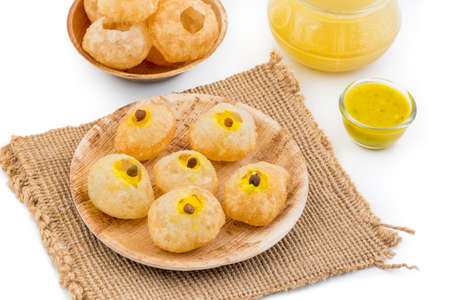 pani puri or golgappa made by fine flour and other spices, Panipuri is the favorite food of Indians and pakisthani Stock Photo