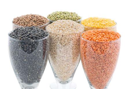 black gram: Variation of lentils, beans, peas, grain ,soybeans, legumes in glasss on white.