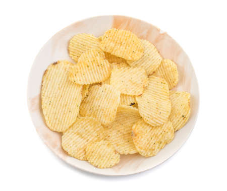 Potato chips in bowl on white