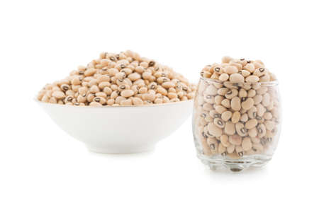 black gram: fresh Black-eyed Beans in the bowl and glass  isolate on white