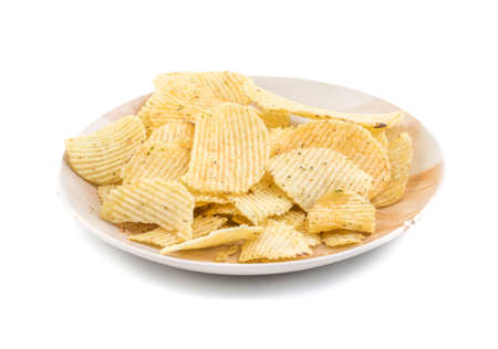 Potato chips on plate isolate on white