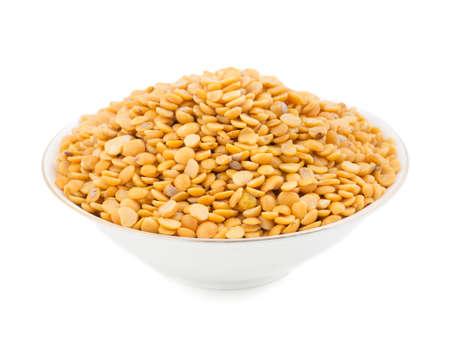 Yellow split peas or toor dal isolate on white Stock Photo