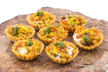 Indian Traditional Street Food Sevpuri or Katori Chaat isolate on white