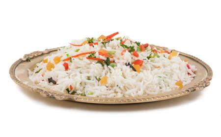 新鮮でヘルシーな野菜チャーハンまたはカシミールの pulav ボウルでお召し上がりいただけます 写真素材
