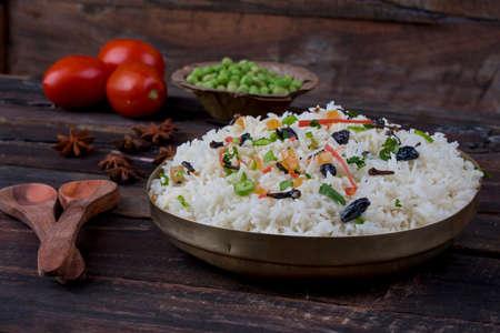 fresh and healthy Veg biryani or kashmiri pulav served in bowl