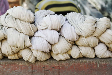 group of washed bed sheet for drying Stock Photo