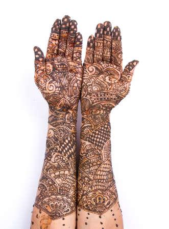 Henna Tatto on hand isolate on black