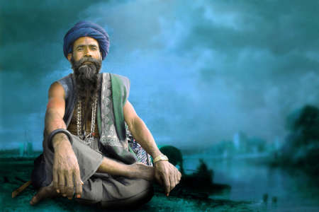 Indian sadhu meditation at bank of holy ganga river