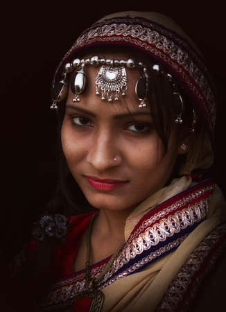 Indian Traditional woman in Rural costume looking at camera Imagens