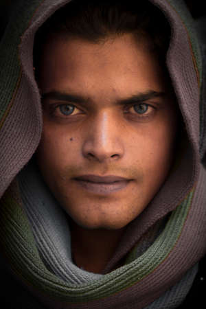 Close-up portrait of threatening gangster wearing a hood, concept of danger Stock Photo