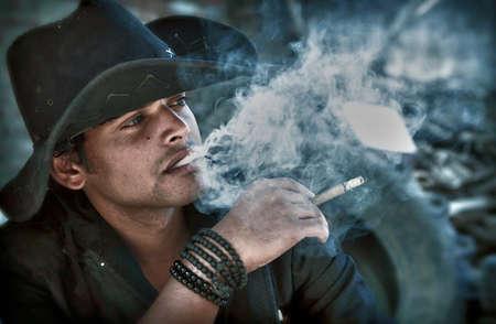 lovely expression of man smoking cigar Stock Photo