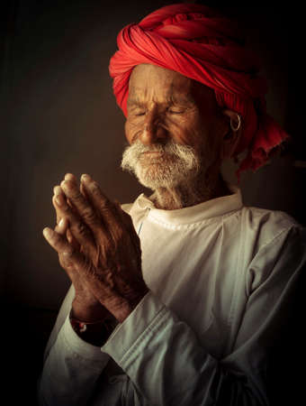 Indian old Man praying to god for every thing good 免版税图像