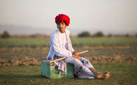 Indian Rural Boy sitting on vintage box