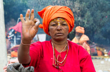 Vastanji, India - January 08, 2014: holy woman at Muni maharaj Temple in vastanji village, Sadhu devoted his whole life in meditation after wear Saffron religion apparel in india, muni maharaj festival held once in every year, all india holy man togther a