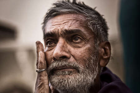 PUSHKAR, INDIA -APRIL 09, 2016: Unidentified Emotional Rural Man Crying and love to pose, about 32.7% percent of Indians are extremely poor yet, Pushkar India, April 09, 2016