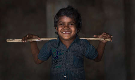 SARNESWAR, RAJASTHAN, INDIA - MARCH 17, 2016, Unidentified Happy Indian rural boy holding old Stick and love to boy poses for camera at Village, Sarneswar, Rajasthan, India 17 March 2016. Editorial