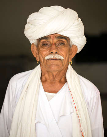 SHEOGANJ, RAJASTHAN INDIA - AUG 18 , 2016: a rural man from choudhary commuinity wearing traditional turban and casual, this community know as Farmer and work for agriculture Editorial