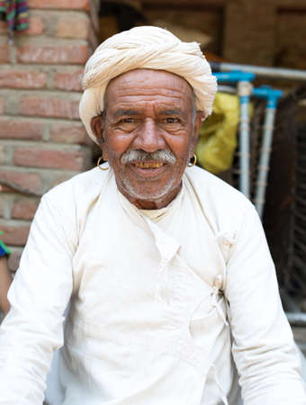 ANDOURE, RAJASTHAN INDIA - JUN 09, 2017:  rural man from choudhary commuinity wearing traditional turban and casual, this community know as Farmer And Herding Animals Editorial