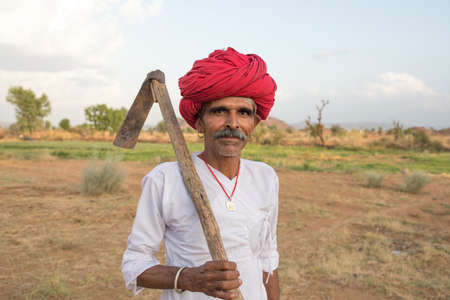 ANDOURE, RAJASTHAN INDIA - JUN 10, 2017:  rural man from choudhary commuinity wearing traditional turban and casual, this community know as Farmer And Herding Animals
