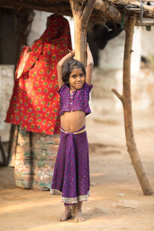 SARUPGANJ, RAJASTHAN, INDIA - JAN 09, 2017 ; An unidentified Indian girl in Village and happy to poses for camera, Sarupganj, Rajasthan-India on Jan 09, 2017