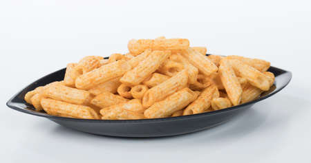 Crispy and crunchy penne pasta shaped snacks food Stock Photo