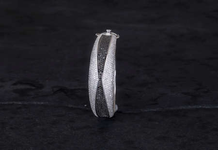 Luxury bracelet 925 Silver finish Isolated on black background Standard-Bild