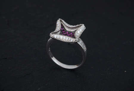 Diamond and gemstone 92.5 Silver Ring under black background