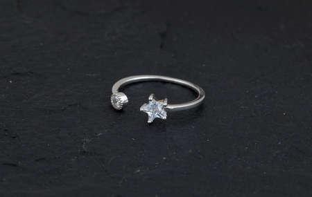 Diamond and gemstone 92.5 Silver Ring under black background