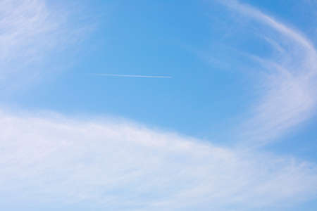Airplane flying in the cloudy sky