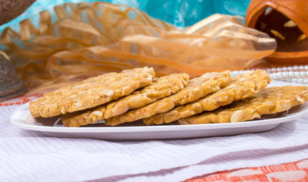 indian festival sweet food Peanus Chikki made by groundnut and jagger, its a favourite of childhood Reklamní fotografie