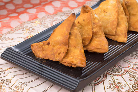 portrait of delicious indian street food samosa Banco de Imagens