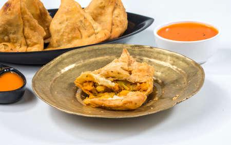 Indian Fried Food Samosa with chutney isolated on white