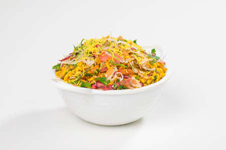 Bhelpuri is savoury snack or chaat. It is made out of puffed rice, vegetables and a tangy tamarind sauce it is also popular street food of india