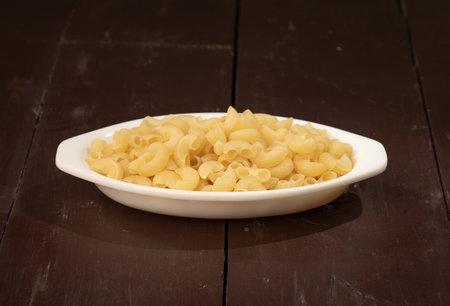 Fresh and healthy raw pasta on wooden background 版權商用圖片