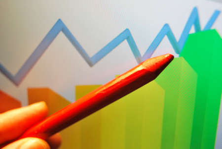 by the lcd screen: Market Analyze on lcd screen pen pointing at a business graph