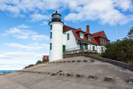 puffy: Point Betsie Lighthouse, Frankfort Michigan. A blue sky with white, puffy clouds, in the background.