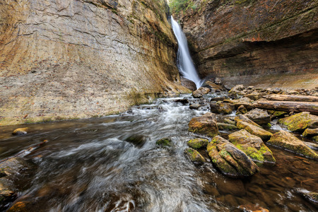 miners: Miners Falls at Pictured Rocks National Lakeshore - Upper Peninsula of Michigan. Miners Falls cascades over rock face and rushes over moss covered boulders on its path to Lake Superior. Stock Photo
