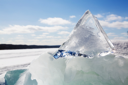 rough diamond: Like a diamond in the rough, this triangular piece of ice juts from another jumbled pile of ice at Grand Island on Lake Superior