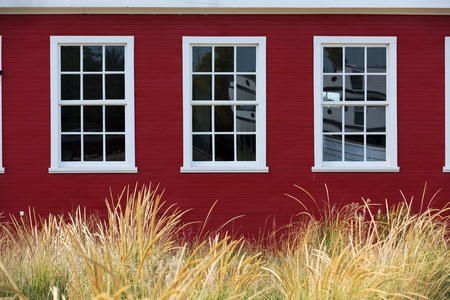 traverse: White Window against Red Barn