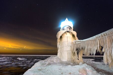 st  joseph: Frozen St. Joseph Lighthouse at night in St. Joseph Michigan.