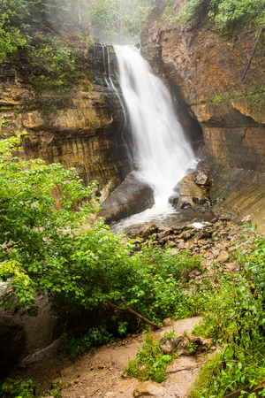 the miners: Miners Falls at Pictured Rocks National Lakeshore - Upper Peninsula of Michigan. Miners Falls cascades over rock face and rushes over moss covered boulders on its path to Lake Superior. Stock Photo