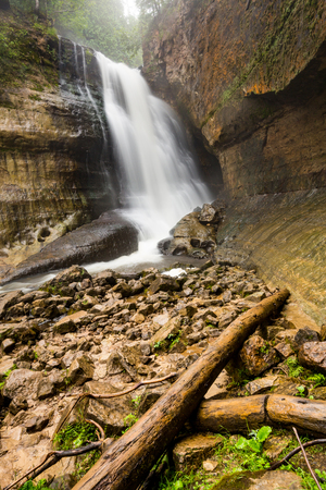 Miners Falls at Pictured Rocks National Lakeshore - Upper Peninsula of Michigan. Miners Falls cascades over rock face and rushes over moss covered boulders on its path to Lake Superior. Stock Photo