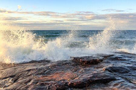 Storm surge drives crashing waves over sandstone rock at Pictured Rocks National Lakeshore in the Upper Peninsula of Michigan, in Munising