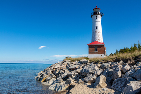 Remote Crisp Point Lighthouse on the rocky shores of Lake Superior in the Upper Peninsula of Michigan.