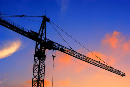 Construction crane at sunset, San Diego, California, USA