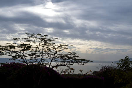 Israel - Sea of Galilee - landscape view with sky full of clouds and little sun goes through Stock fotó