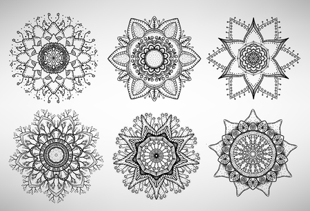 Collection of six doodled mandalas, flower shapes