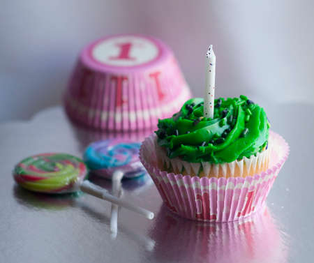 first birthday: Pink first birthday celebration cupcake and lollipops